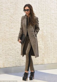 Making her arrival: Victoria Beckham pulled together an uber-stylish matchy-matchy ensemble for her arrival in New York on February 6, 2916