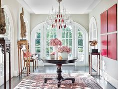 In the foyer, a modernist Baccarat crystal-and-wire chandelier and Asian artifacts set the tone for the house. - Photo: Emily Jenkins Followill / Design: Vern Yip