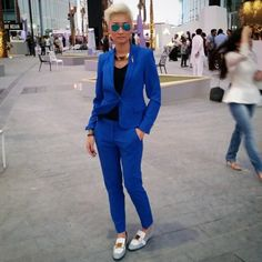 gold necklace + cobalt blue suit + black tank + white, gray, and gold loafers