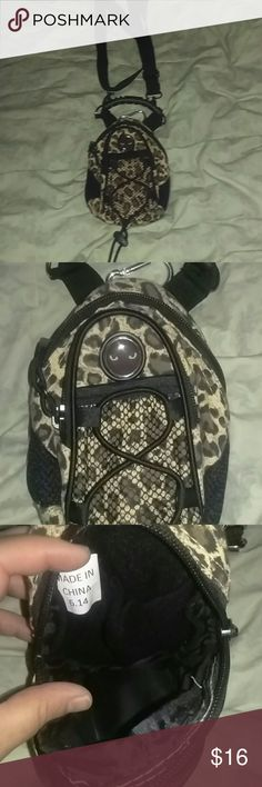 Travel cheetah bag adjustable straps key hook more Travel travel cheetah bag adjustable straps key fob two zippers for Stuff one pocket on the front two on the inside comes with handle and cat eyes in the front. Super cute used when a big purse is not needed perfect for ID and the little things you may need please ask questions love offers love the bundle to save you money it measures 8x6 x 2 thank you for looking. no brand shown Bags Mini Bags