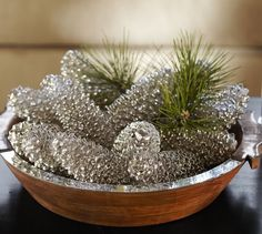 Spray paint pine cones to look like mercury glass