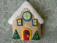 This is a Gingerbread house ornament, 2 1/2 in x 2 1/4 in The house is hand made and embroidered to order Please specify name you would like