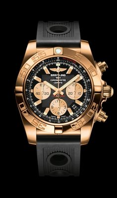 Chronomat 44 diver's watch by Breitling - 18K rose gold case, onyx black dial, black Ocean Racer strap.
