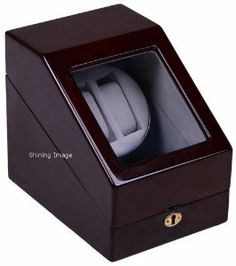 "Top Quality Double Automatic Wood Watch Winder with 3 storages by shining image. $59.95. The front compartment of the winder has storage accommodations for an additional 3 fine watches and a quality lock mechanism to keep your watches safe. Computer controlled timer permits flawless winding of all automatic timepieces.. Quiet motor. Runs on 2 AA batteries or with the included AC adapter. Dimension: 7"" wide x 9.25"" deep x 8"" high.. Rotating base allows easy access ..."