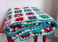 A granny blanket with lots of blue and white. ♥