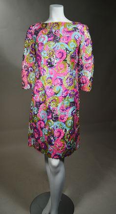 SPARKLE PLENTY! PASTEL SWIRL PATTERN SOLID SEQUIN 1960's VINTAGE MINI DRESS.  Available for sale at rpvintage.com.