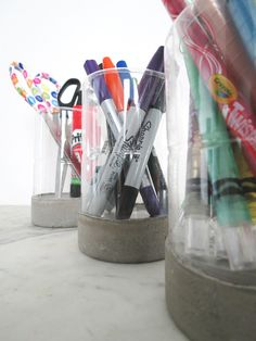 Make a pencil holder from a tuna can and a plastic bottle
