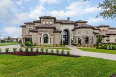 Mediterranean style waterfront home with stucco and stone exterior located in Majestic Pointe, a gated neighborhood. Dream Home Design, House Design, Stucco And Stone Exterior, Westport Homes, Spanish Design, Rich Home, Spanish House, Mediterranean Homes, Waterfront Homes