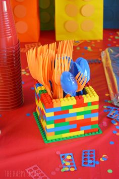 LEGO Birthday Party - The Happy Scraps Lego birthday party utensil holder<br> This Lego Birthday Party was simple to put together and lots of fun. Come to The Happy Scraps to see how to put this party together for yourself. Spongebob Birthday Party, Birthday Party Places, 6th Birthday Parties, Diy Birthday, Lego Birthday Cakes, Diy Lego Birthday Party Ideas, 5th Birthday Ideas For Boys, Lego Parties, Lego Party Favors