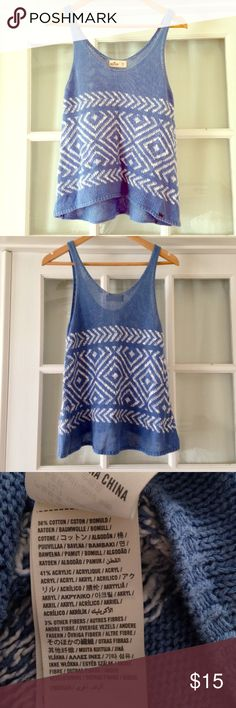Hollister Sweater Tank size XS Tank top from Hollister. Sweater material. 56% cotton, 41% acrylic, 3% other fibers. Aztec detailing stitched into top. High low hem. Never been worn. Hollister by Abercrombie and Fitch. Hollister Tops Tank Tops