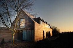 situated within a traditional neighborhood in luxembourg, this residence celebrates a contemporary appearance while maintaining the area's topological gabled roof.