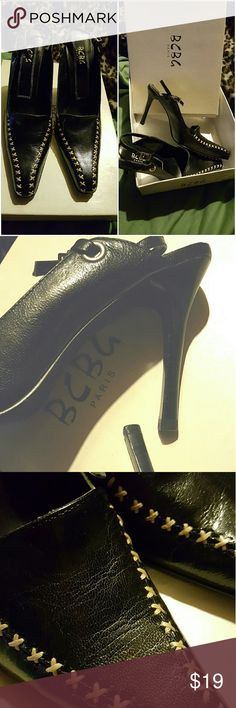 BCBG slingbacks Black pointy slingbacks with gorgeous cream colored stitching; grommet detail and silver buckle; bought second hand and didn't use. Kept in the original box. Sole and heel in great condition. These are for a slim foot and I usually need a medium or wide. BCBG Shoes Heels