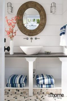 Beachy outdoor bathroom with white wood paneled walls and mosaic pebble floor. Pool Bathroom, Bathroom Sconces, Pool Bad, Wood Panel Walls, Paneled Walls, White Wood Paneling, White Vessel Sink, Reclaimed Wood Mirror, Grey Countertops