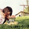 Young girl caring for baby chickens