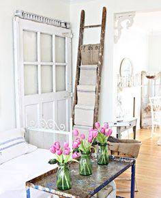 If you're short on closet space, a vintage ladder can store towels and other linens in style.