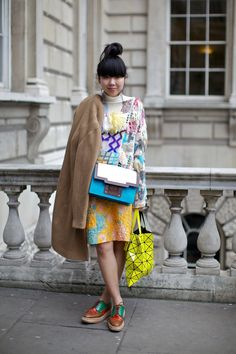 Susie Lau (Susie Bubble) outside Somerset House at London Fashion Week, February 2012. Photographer: Marcus Dawes