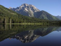 "Alpine lakes beneath Tetons await hikers. Learn about other great trails in ""Best Sights to See at America's National Parks"": http://www.amazon.com/Sights-Americas-National-Parks-Hittin-ebook/dp/B018W7Y288"