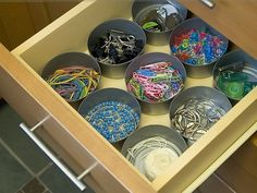 These tuna cans are an economic way to help organize contents of a drawer.