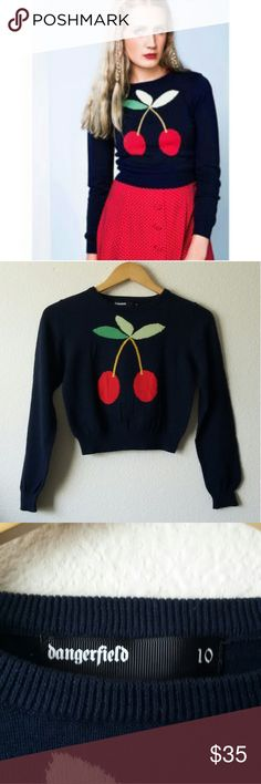 Dangerfield cherry cropped sweater Cute vintage-inspired cropped sweater with a cherry design from Australian brand Dangerfield. The sweater looks black on the photos but it is more of a dark blue color. Wear it alone with high waisted skirt (or pants) or layer it over a collared button down shirt for a more preppy look. In great condition. Size 10 in Australia, which fits size small or extra small in the U.S. Length 16.5, bust 15.5, waist approx. 12 unstretched. Dangerfield Sweaters Crew…