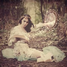 She felt the mirror tugging her hand again. Panicing, Mia skimmed through the pages trying to find the spell she wanted before the Wizard completed the flow of magic that would pull her from this place forever.