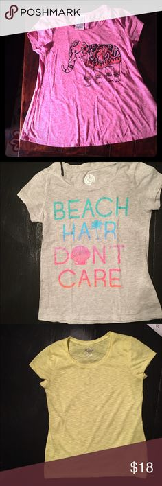 """4 girl's size 10/12 t shirts 4 girl's t shirts. Good condition. 1) """"Lily Bleu""""ranked pink shirt sleeve trapeze top. Graphic of elephant with sparkles on front. 2) grey """"So"""" brand short sleeve tee """"Beach Hair Don't Care"""" blue green and pink sparkly lettering 3) yellow short sleeve tissue tee Justice size 10 slight pilling 4) pink high low trapeze top """"fifth sun"""" brand (Kohl's) says """"I can't even."""" Justice Shirts & Tops Tees - Short Sleeve"""