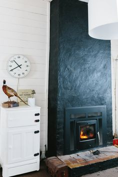 I like the black fireplace wall with white everything else and no mantle. Marnie & Ryan's Vintage Treasures Country House