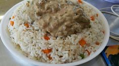 Creamy chicken and muchrooms on top of rice. Made by little Marah