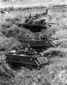 M113 APC's with a M-48 Patton supporting infantry in Vietnam.