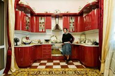 I love this kitchen! Small yet very modern and RED!!!! (love the curtains and the rug too!)