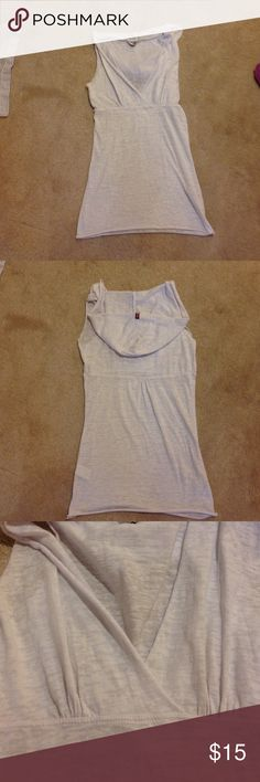 Sleeveless tank top This is an adorable V neck , sleeveless hoodie. It is a small but it fits more like an extra small. I love it but it is a bit too tight for me Hard Tail Tops Sweatshirts & Hoodies