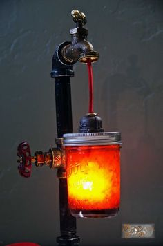 Industrial Pipe Mason Jar Lamp. See more cool industrial DIY lamps on the blog.