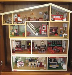 Vintage Lundby Dollhouse with extensions. 70s/80s - mine was mid 80s. Real lights and everything! Sadly, mine was eventually sold in a garage sale (thanks, Mom). I miss it. Even if it does look really dated now.