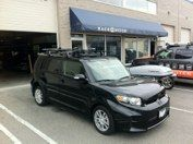 Scion xB with a Yakima  roof rack system including a Showboat boat loader #hitchngear