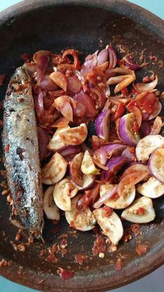 Smoked salted fish with eggplant sambal. Indonesia.