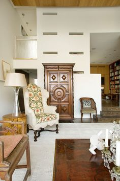 5. Keep scale in check. This large-scale wing chair would have overpowered the space were it covered entirely in a bold print. Upholstering just the back and the seat helps it to feel more appropriate for the size of the room.