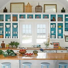 Love the cabinets. Love the view they frame even more, but certainly white cabinets with glass fronts and turquoise interiors highlighting clean, bright dishes. Yes, please.