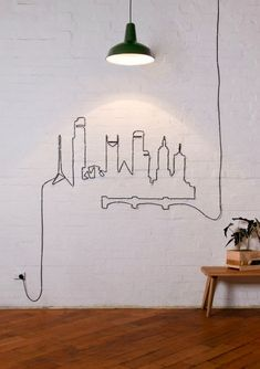 Cable City Skyline - Wires in a home can easily get in the way and just look plain unattractive. But why not use the wires to your advantage and be creative with them? Use wire clips along the wall and construct a design you'd be happy to view every day. Below is an example of what can be done.