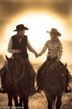 Cowboy and cowgirl romantic horseback sunset engagement shot