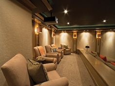The owner selected acoustical fabric for the walls and #furniture in this home theater built by Bethesda Systems. #interior #design #furnishings