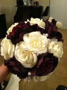My Co-Maid of Honor's Bouquet: Faux Floral includes Deep Plum stemmed roses and Stemmed Ivory roses. Her bouquet is twice the size of my other bridesmaid's bouquets. * We have yellow roses just like this at Luscious soul
