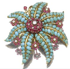 A turquoise and ruby sea star brooch by John Rubel, 1940's.