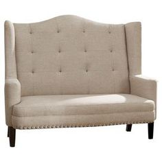 """Showcasing a wingback silhouette highlighted by nailhead trim, this linen-upholstered settee brings a touch of glamour to your living room or parlor.   Product: SetteeConstruction Material: Birch wood, engineered wood, foam and linenColor: BeigeFeatures: Wingback silhouetteNailhead trimButton-tufted19.25"""" Seat heightDimensions: 50"""" H x 59"""" W x 32.75"""" DAssembly: Some assembly required"""
