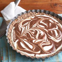 Long considered a traditional Christmas beverage, eggnog is blended with chocolate and rum and then divided into two separate fillings to create this elegantly swirled pie recipe.