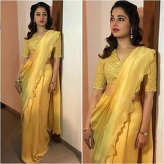 Tamanna Bhatia for one of the event at trichy, she was seen in mustard yellow saree by Ankur Modi & Priyanka Modi Saree ( AM PM) .She finished her look with wavy hair and simple make up. Trendy Sarees, Stylish Sarees, Fancy Sarees, Party Wear Sarees, Drape Sarees, Saree Draping Styles, Saree Styles, Work Sarees, Blouse Styles