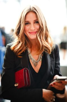 Olivia Palermo looking like a Bstyler. Great necklace and - look! - is she checking a price with her new sales floor app?!
