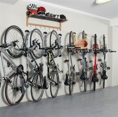 The Steady Rack bike storage rack allows you to store multiple bikes on the wall in a small space. Ideal for an apartment, office, garage, loft, etc. Bike Storage Shelf, Vertical Bike Storage, Indoor Bike Storage, Garage Storage Racks, Hanging Storage, Garage Organization Bikes, Bike Storage For Small Spaces, Bike Storage Office, Wall Mounted Bike Storage