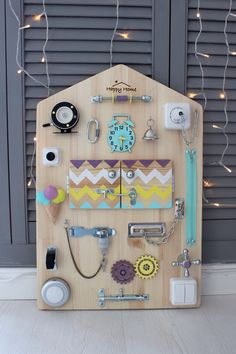 Busy board or Happy Home is a developing board in which every detail is thought over in detail. Here elements of sound and light can be easily felt. These elements are necessary for developing small hand motorism and of course for mental development. Its connected with a childs