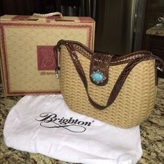 NWOT Brighton straw purse Pristine condition!!!!  Comes with dust cover and box. Would make a great gift for Mothers Day Brighton Bags