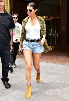Selena Gomez steps out in a white tank, denim shorts, ankle boots, a printed jacket and a black belt.