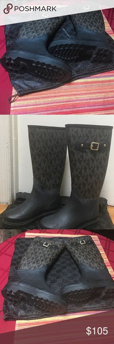 """Womens Michael Kors Logo Tall Rain Boots Women's Michael Kors Logo Tall Rain Boots.  Perfect for any fashionista's wardrobe. Worn only once indoors, Christmas Day. These MK boots are a size 6M and are solid black with brown MK logos on the upper boot. The upper logo portion is textured. They are tall and have a brass buckle on each side. They slide on and are waterproof. Rubber with MK logo print. Brushed brass hardware. Roller buckle detail. 15"""" calf circumference. Boot height is 12 3/4""""…"""